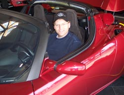 Mike Gray Sitting in a Tesla Roadster at Menlo Park, California